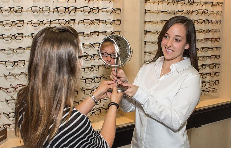 Dr. Jeni helping pick out frames