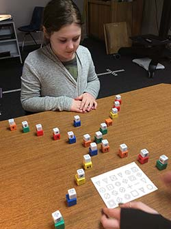 girl participating in vision therapy program